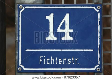 MUNICH, GERMANY - MARCH 3, 2012: Traditional blue street sign at Fichtnerstrasse 14 in Munich, Bavaria, Germany.
