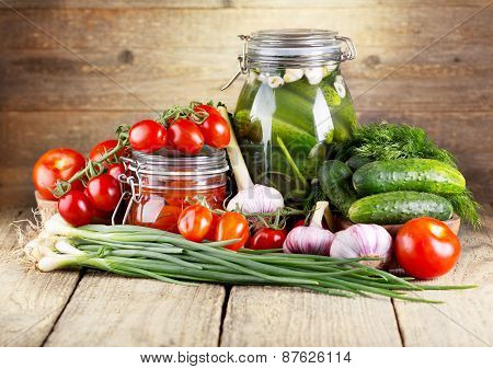 Preserved Tomatoes And Cucumbers With Fresh Vegetables