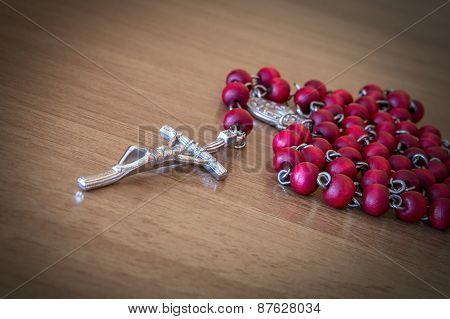 Red rosary beads with crucifix