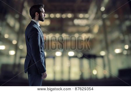 Businessman standing next to an apartment window