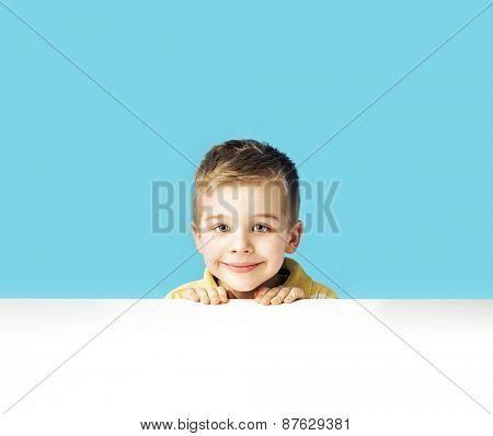 Young boy on blue background
