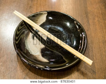 Black Plate With Wooden Chopsticks