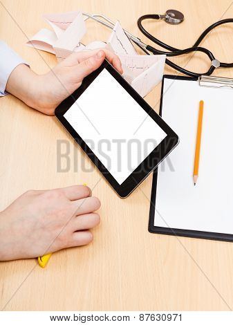 Doctor Looks On Tablet Pc With Cut Out Screen