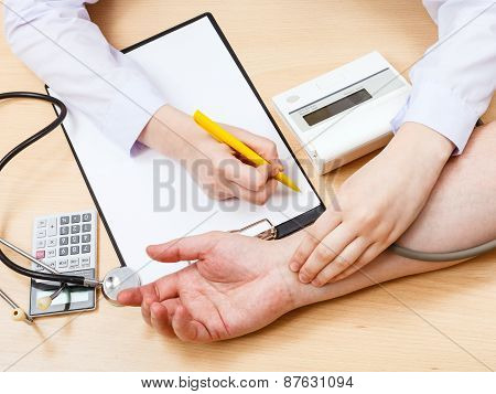 Doctor Measures Blood Pulse Of Patient