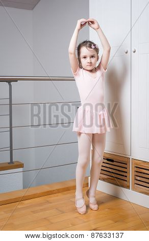 Little girl practicing ballet
