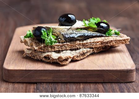 Sandwich With Sprats And Olives