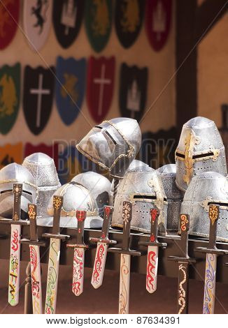 An Assortment Of Helmets, Shields And Swords