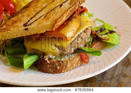 Homemade cheeseburger with a fresh lettuce and red pepper