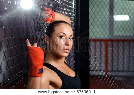 Female fighter in a cage