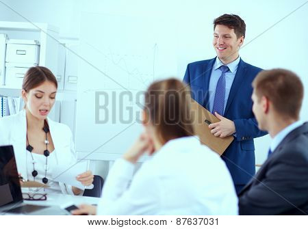Business people sitting and discussing at business meeting .