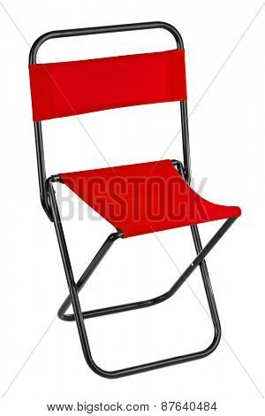 Red folding chair isolated on white background