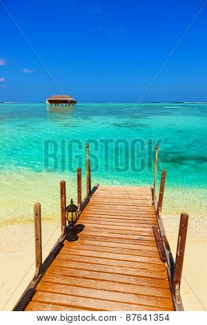 Water bungalow on Maldives island - nature travel background