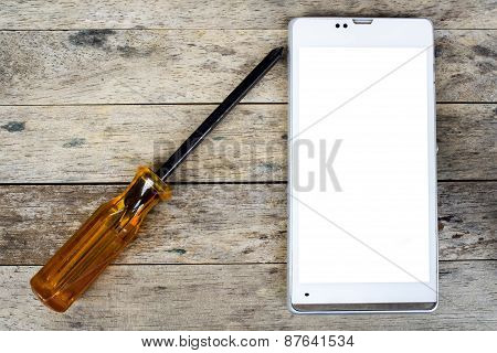 Smart Phone And Screwdriver For Repair On Wood Plank,  Top View, White Screen
