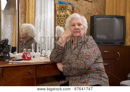 Portrait Of Senior Woman Near The Mirror
