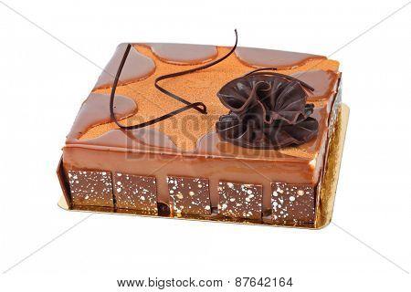 Big chocolate cake isolated on white background