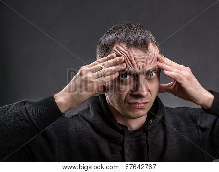 Unhappy man thinking
