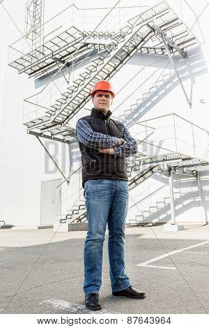 Architect Posing Against Metal Construction