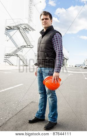Manager Worker Standing On Rad Against Big Factory