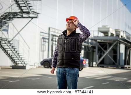 Smiling Engineer In Hardhat Posing On Construction Site