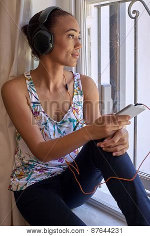 content young woman relaxing with headphones listening music