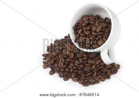 Overturning Cup With Scattered Grain Coffee