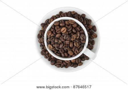 Cup And Saucer, Filled With Roasted Coffee Beans