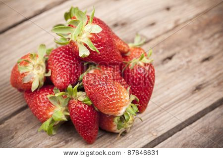 Closeup of fresh strawberries on old table
