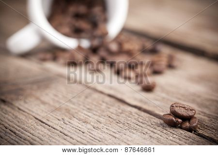 Coffee beans on a old table