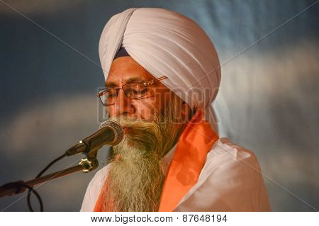 Sikh Devotee With White Turban