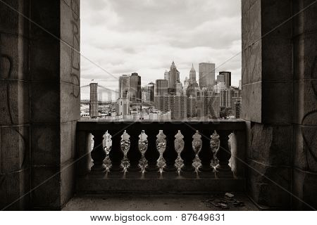 New York City downtown architecture skyline through abandoned balcony.