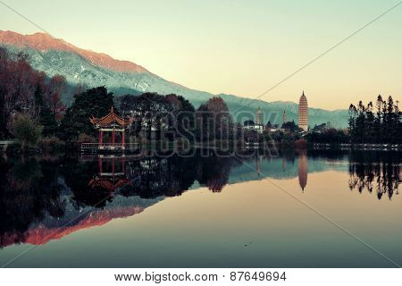 Dali Three pagoda and lake reflection at sunrise in Yunnan, China.