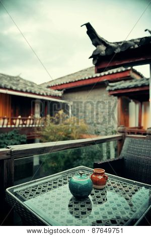 Old Naxi style courtyard and tea pot  in Lijiang, Yunnan, China.
