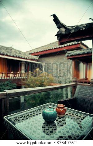 Old Naxi style courtyard and tea pot  in Lijiang, Yunnan, China.