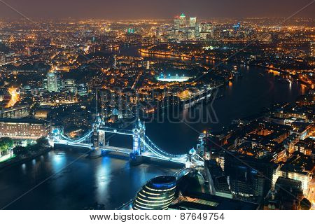 London aerial view panorama at night with urban architectures and Tower Bridge.