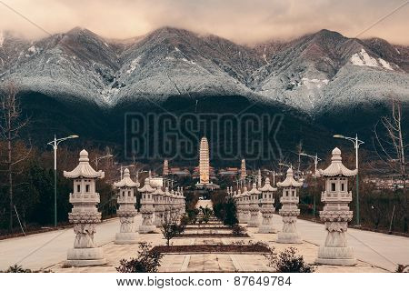 Ancient pagoda in Dali Chongsheng Monastery with snow capped Mt Cangshan, Yunnan, China.