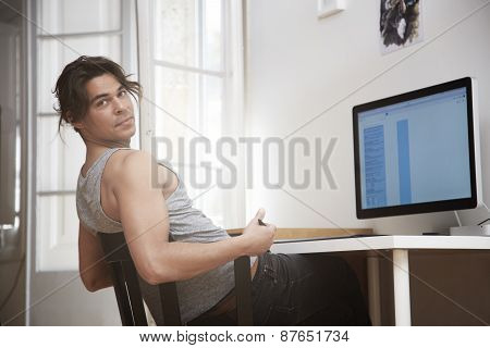 Young Man Working In His Cosy Apartment