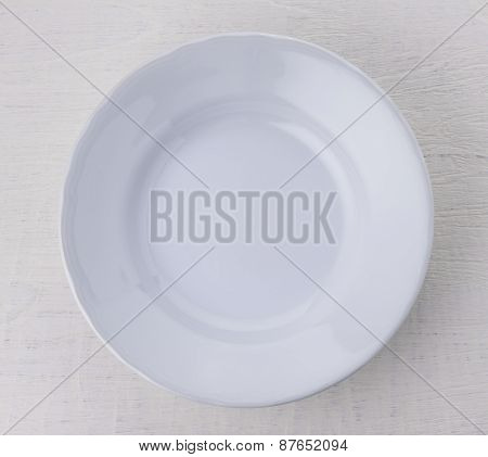 Empty White Ceramic Plate On Wooden Table