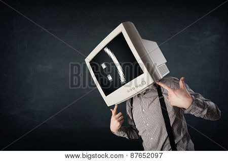 Funny young businessman with a monitor on his head and smiley on the black screen