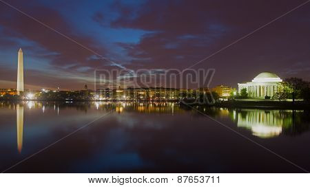Washington Monument and Jefferson Memorial at night with city skyline.