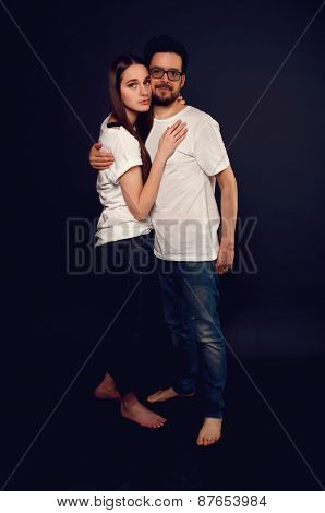 Young Couple Embracing And Looking At Each Other