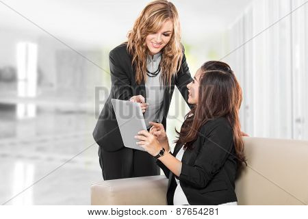 Two Young Businesswoman Wtih A Tablet