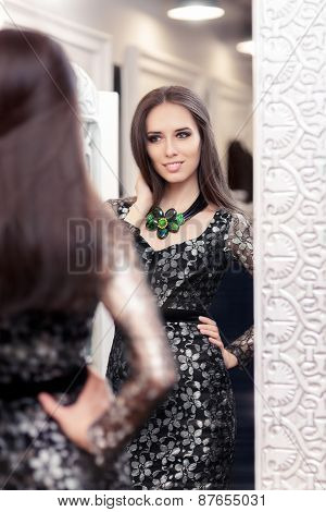 Beautiful Girl in Black Lace Dress Looking in the Mirror