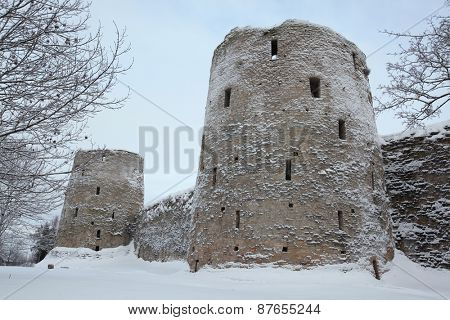Ryabinovka Tower (R) and Vyshka Tower (L) of the Izborsk Fortress near Pskov, Russia.