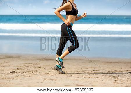 Female jogger  on the beach