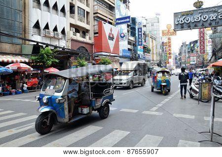 Tuk Tuk Taxi Transports Passengers In Bangkok