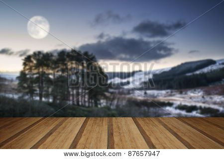 Beautiful Pre-dawn Winter Landscape Over Woodland In Countryside With Wooden Planks Floor