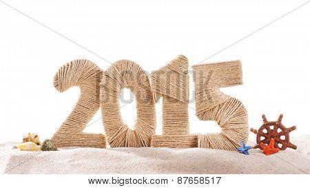 2015 sign on beach sand