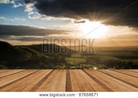Stunning Summer Sunset Across Countryside Landscape With Dramatic Clouds With Wooden Planks Floor