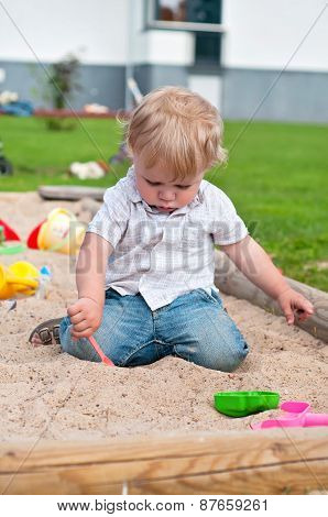 Child playing on playground in sandbox