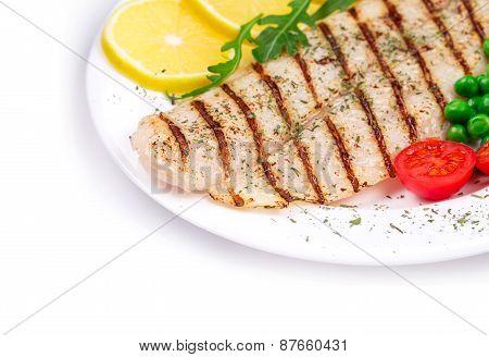 Grilled fish fillet with vegetables.